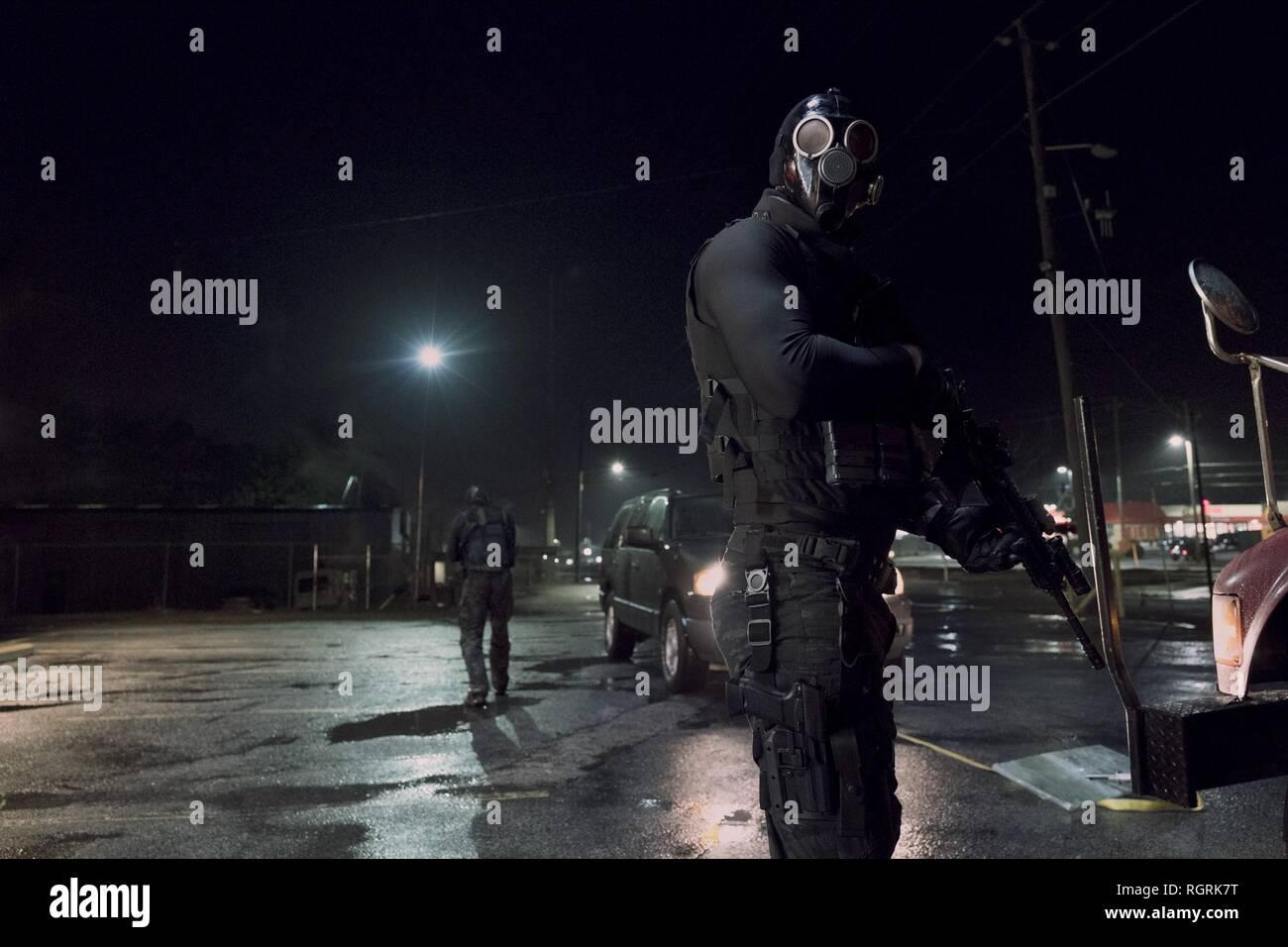 Asaltantes enmascarados armados guarida de ladrones (2018) Imagen De Stock