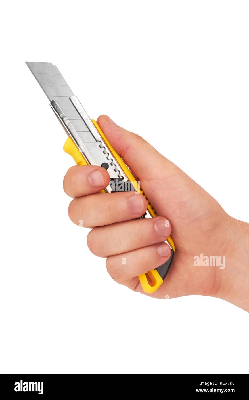 Mano sujetando la herramienta Cuchilla de corte aislado sobre fondo blanco.  Imagen De Stock 94105d52d878