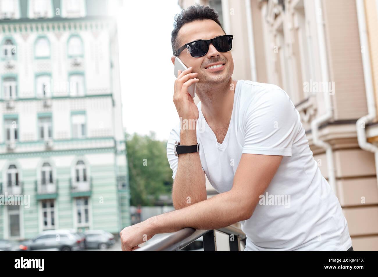 b56bad9f65 Happy Businessman Answering Smartphone Imágenes De Stock & Happy ...