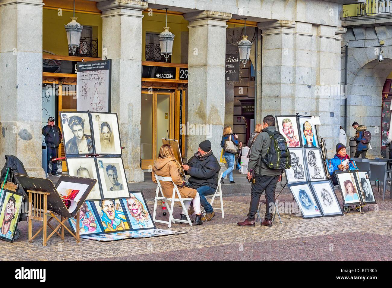 Tu fotografia del dia - Página 3 El-22-de-enero-de-2019-la-plaza-mayor-de-madrid-un-dibujante-de-la-calle-haciendo-un-retrato-de-una-mujer-rt1r05