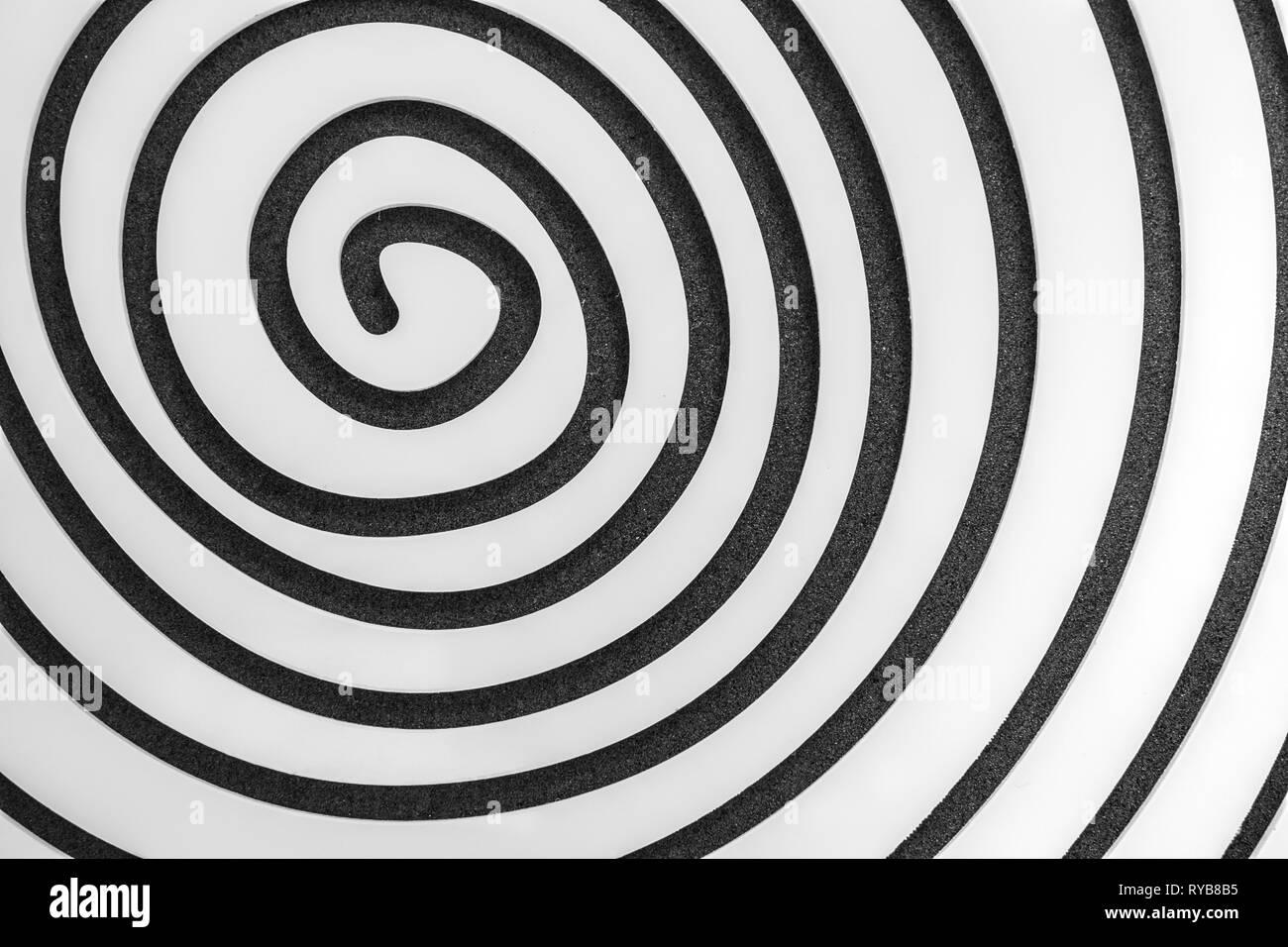 Espiral simple en blanco sobre fondo negro Imagen De Stock