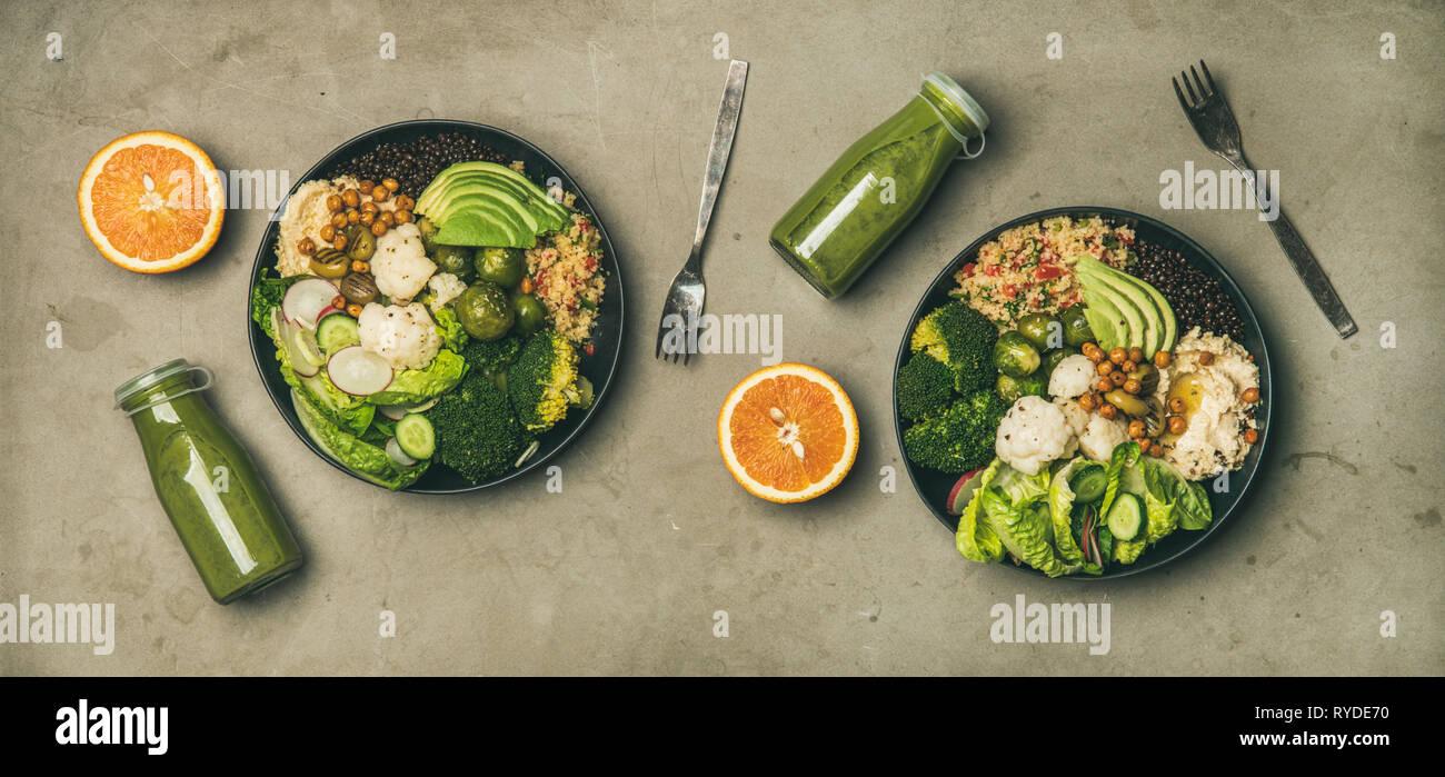 Cena, Almuerzo saludable. Plano de laicos superbowls vegano o Buda cuencos con hummus, verduras, ensaladas frescas, los frijoles, el cuscús, el aguacate y el verde s Imagen De Stock