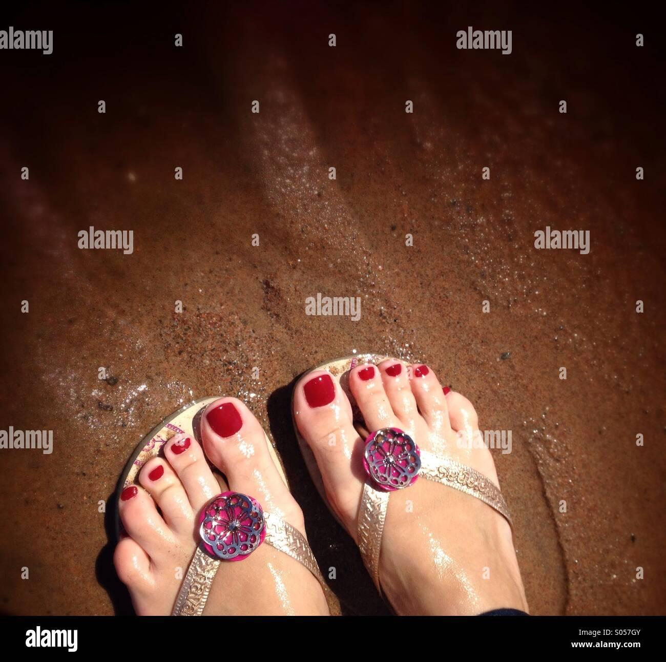 Pies en la playa Imagen De Stock