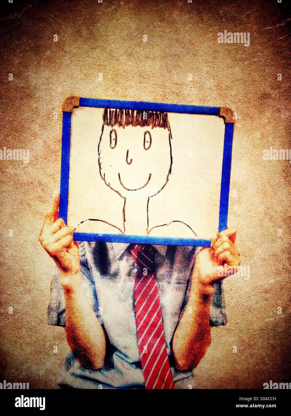 Joven sosteniendo una pizarra blanca con caricatura delante de su rostro Imagen De Stock