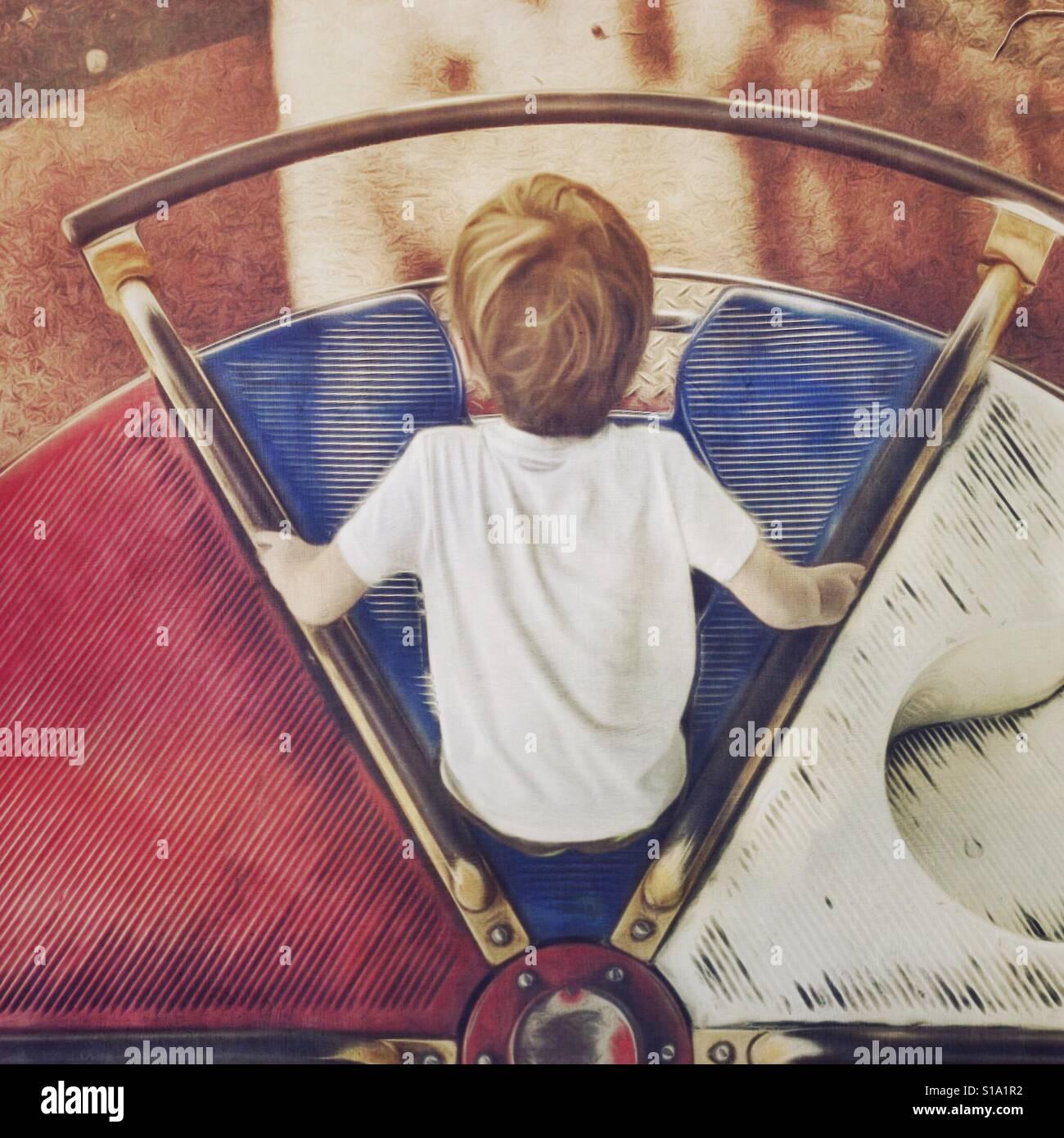 Sobrecarga de niño en la rotonda Foto de stock