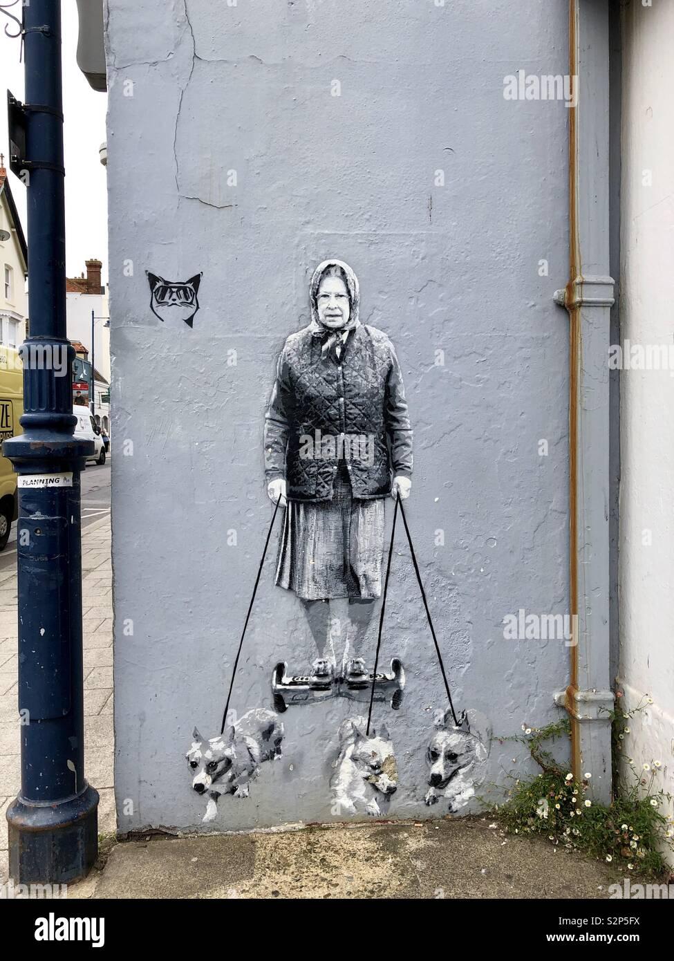 Catman graffiti-Reina y corgis Foto de stock