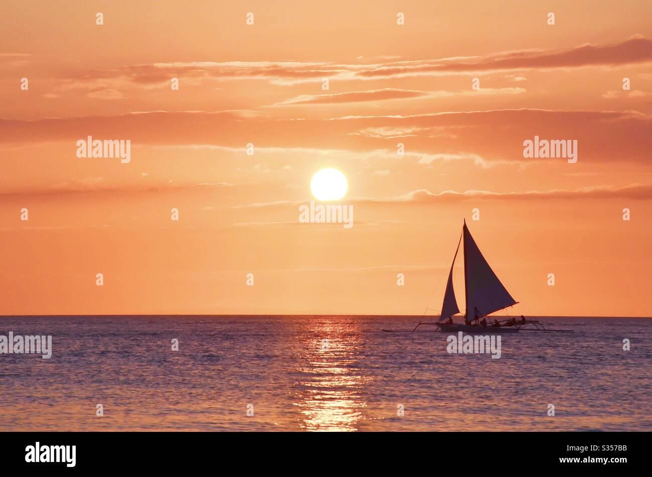 Vela puesta de sol Foto de stock