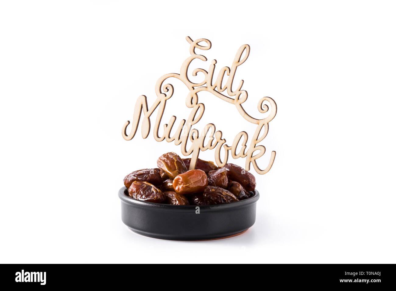 Fechas y Eid Mubarak mensaje aislado sobre fondo blanco. Foto de stock