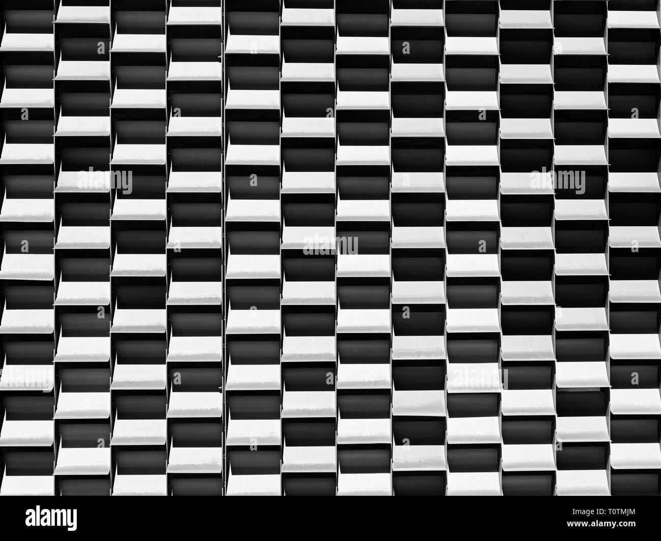 Patrón de cuadros en blanco y negro, fondo o abstractos de diseño simétrico, concepto de arreglo ordenado. Foto de stock