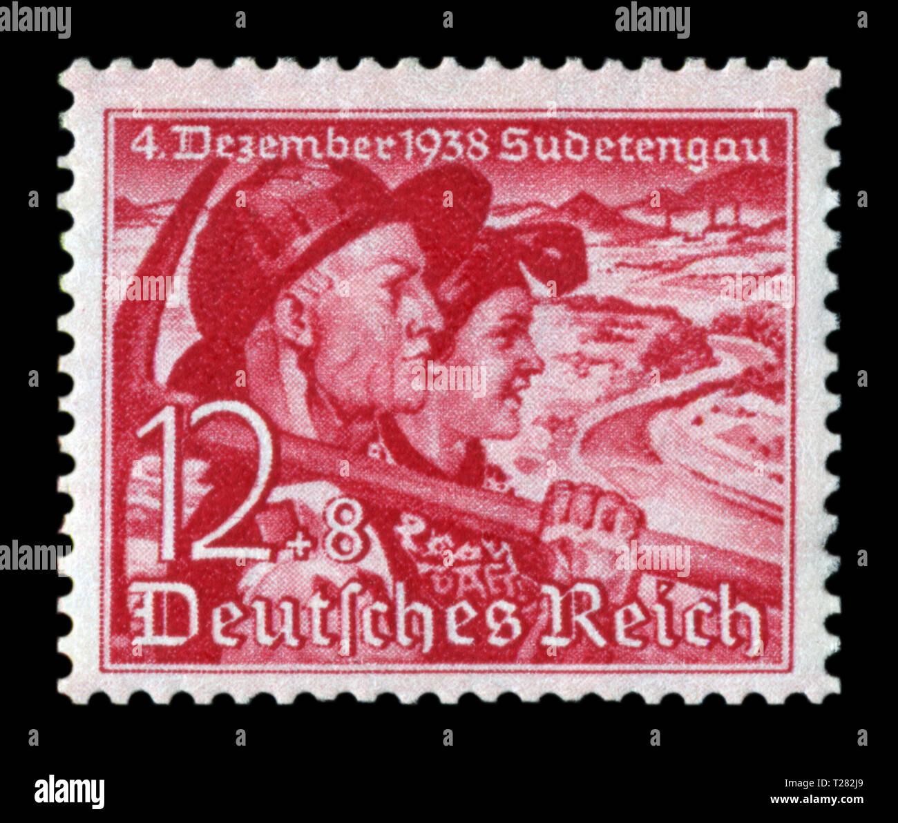 Sello histórico alemán: plebiscito sobre la adhesión de los Sudetes. Pareja. Miner con un pico y una mujer campesina, 12+8 pf, número 1938, Alemania Foto de stock