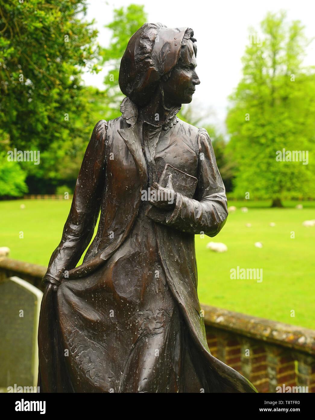 Jane Austen escultura en el cementerio en Chawton, Hampshire Imagen De Stock