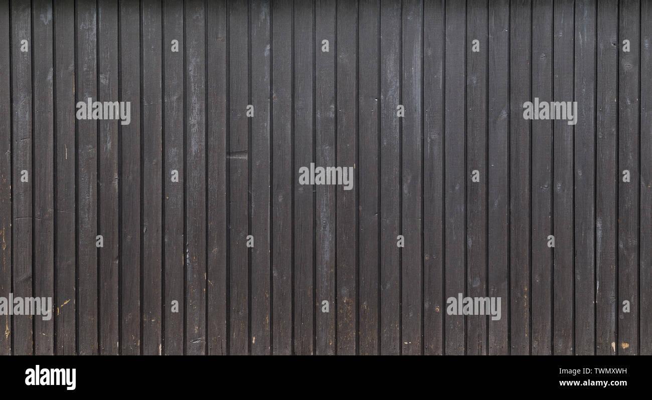 Antecedentes de fotograma completo de alta resolución de una junta de madera desgastada o paneles de pared pintada en gris. Copie el espacio. Imagen De Stock