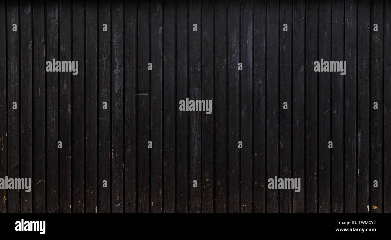 Antecedentes de fotograma completo de alta resolución de una junta de madera desgastada o paneles de pared pintada en gris oscuro realmente. Copie el espacio. Imagen De Stock