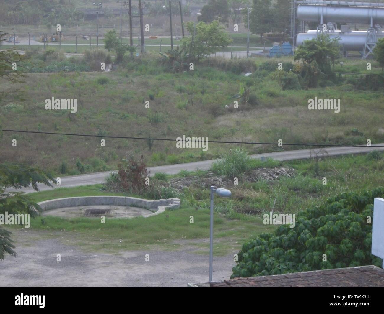 """""""Inglés: pozo de agua situado dentro de Muk Wu Village, cerca de Hong Kong; el 22 de marzo de 2006; el propio trabajo por el uploader original; Yatinngto; ' Imagen De Stock"""