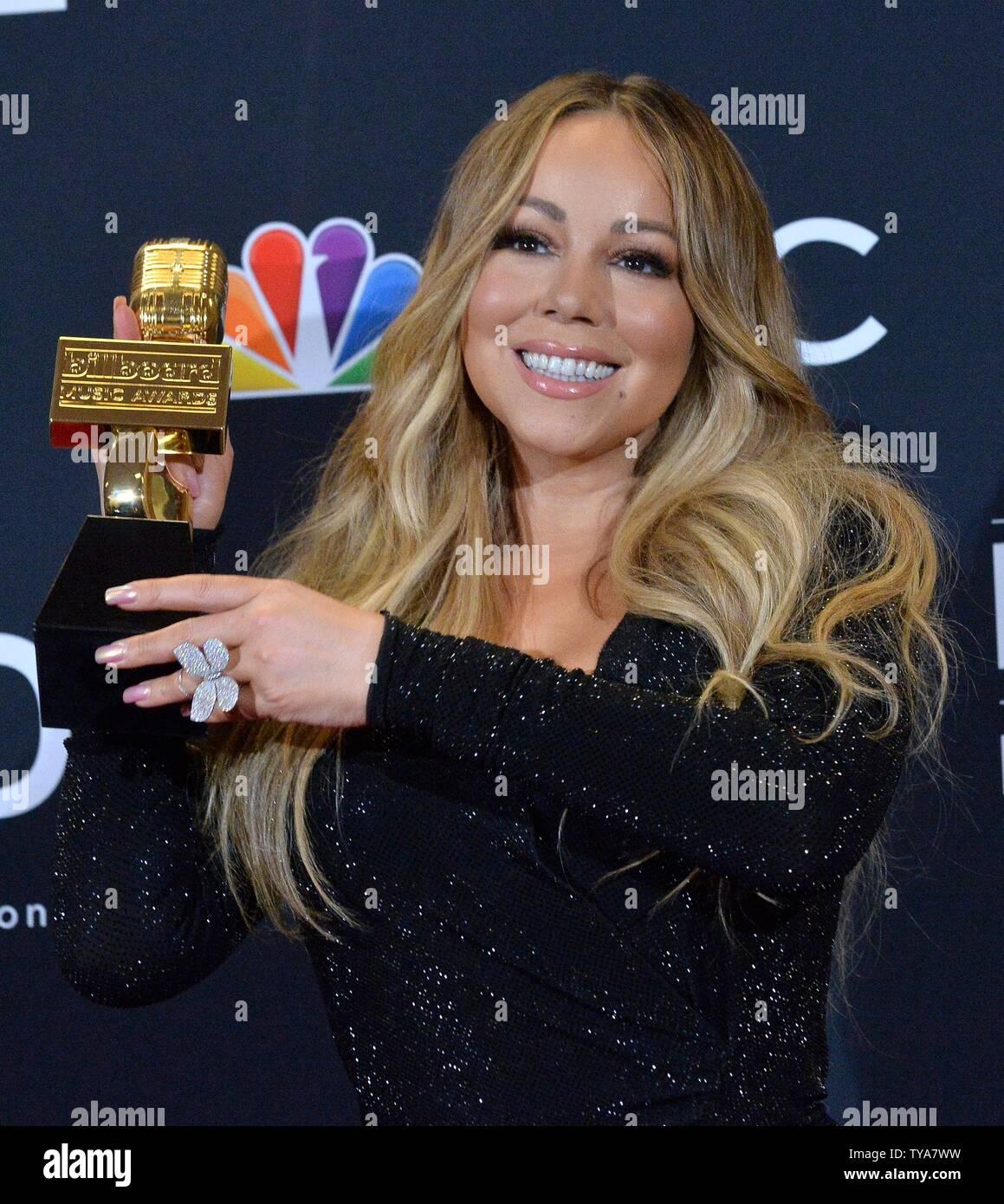 Mariah Carey aparece backstage después de ganar el premio Icono durante el 2019 Billboard Music Awards en el MGM Grand Garden Arena en Las Vegas, Nevada, el 1 de mayo de 2019. Foto por Jim Ruymen/UPI Foto de stock