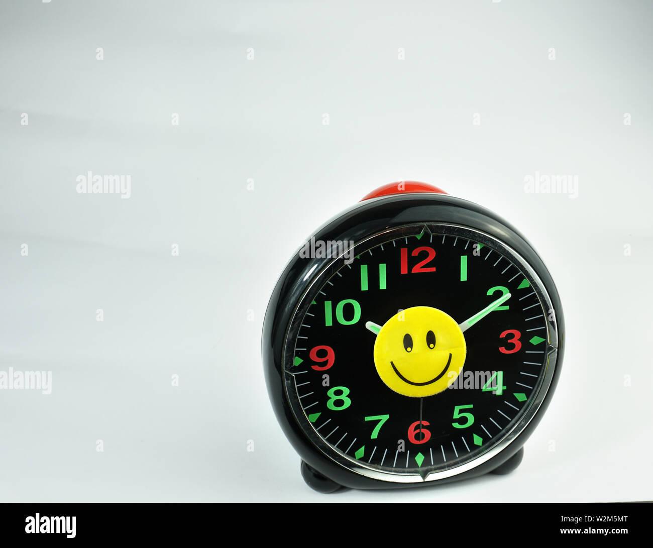 Felicidad sonriente cara feliz en el monedero, BLUE CAP, cartera, reloj, lápiz Foto de stock