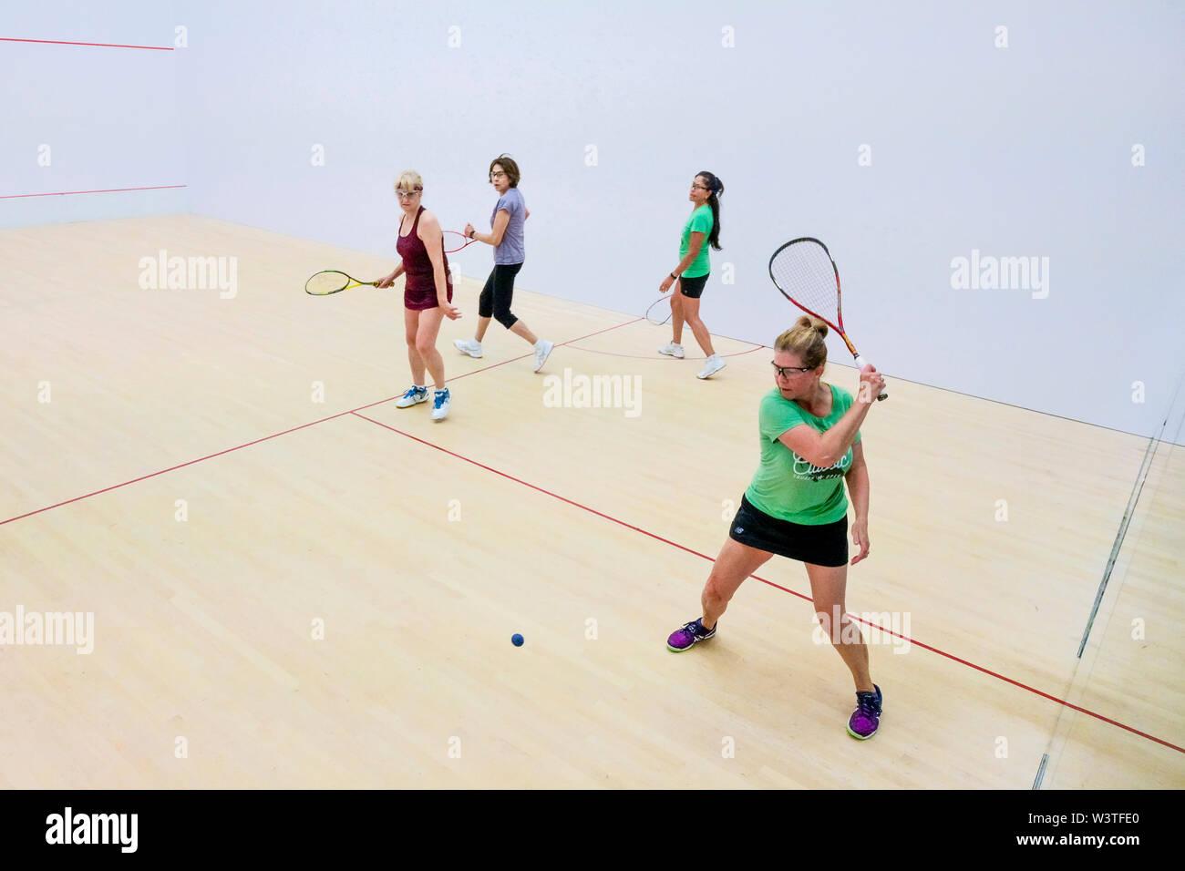 La mujer, duplica, Squash, juego, coincidir Foto de stock