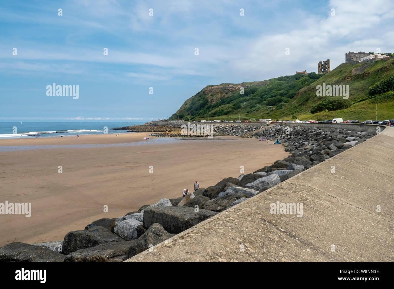 03/08/2019, Scarborough, North Yorkshire, Reino Unido las personas en Scarborough Beach disfrutando un día en thbe seaside en un caluroso día de verano de agosto Foto de stock