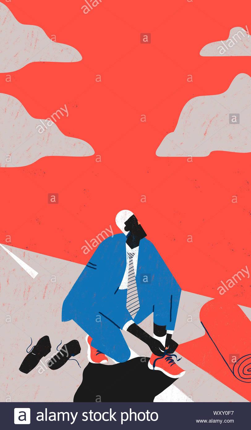 La importancia de la correcta actitud mental para negocios y proyectos. Empresario es poner en red el calzado de deporte que simbolizan buena actitud mental. Foto de stock