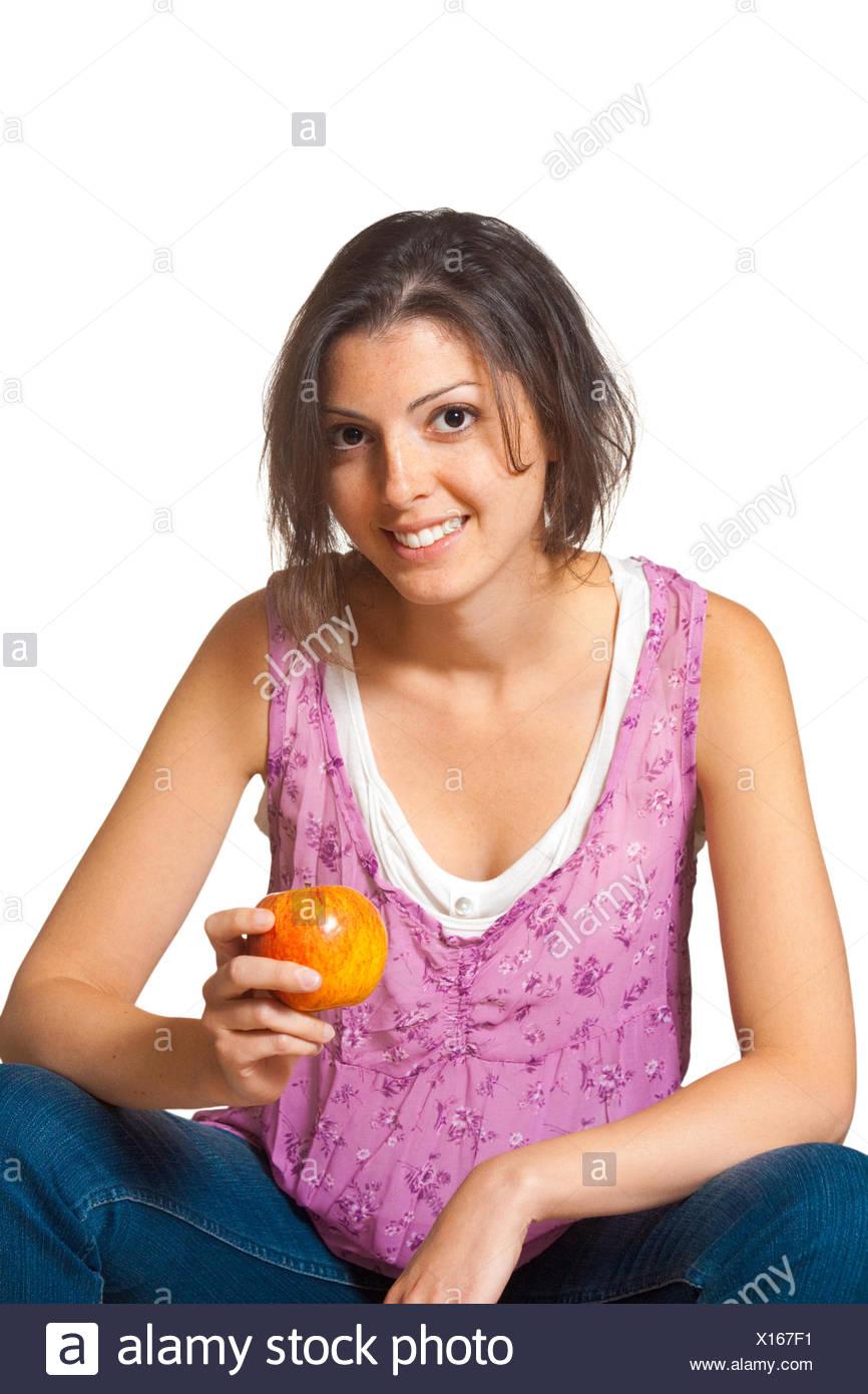 Mujer relajado la celebración ocasional de Apple Imagen De Stock