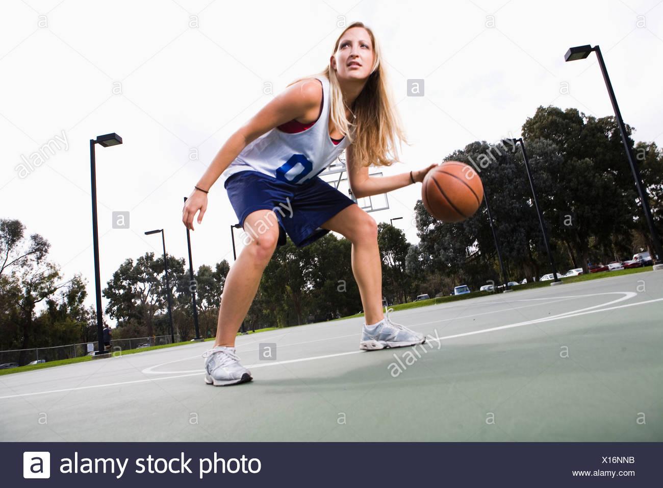A Woman Playing Basketball Imágenes De Stock A Woman