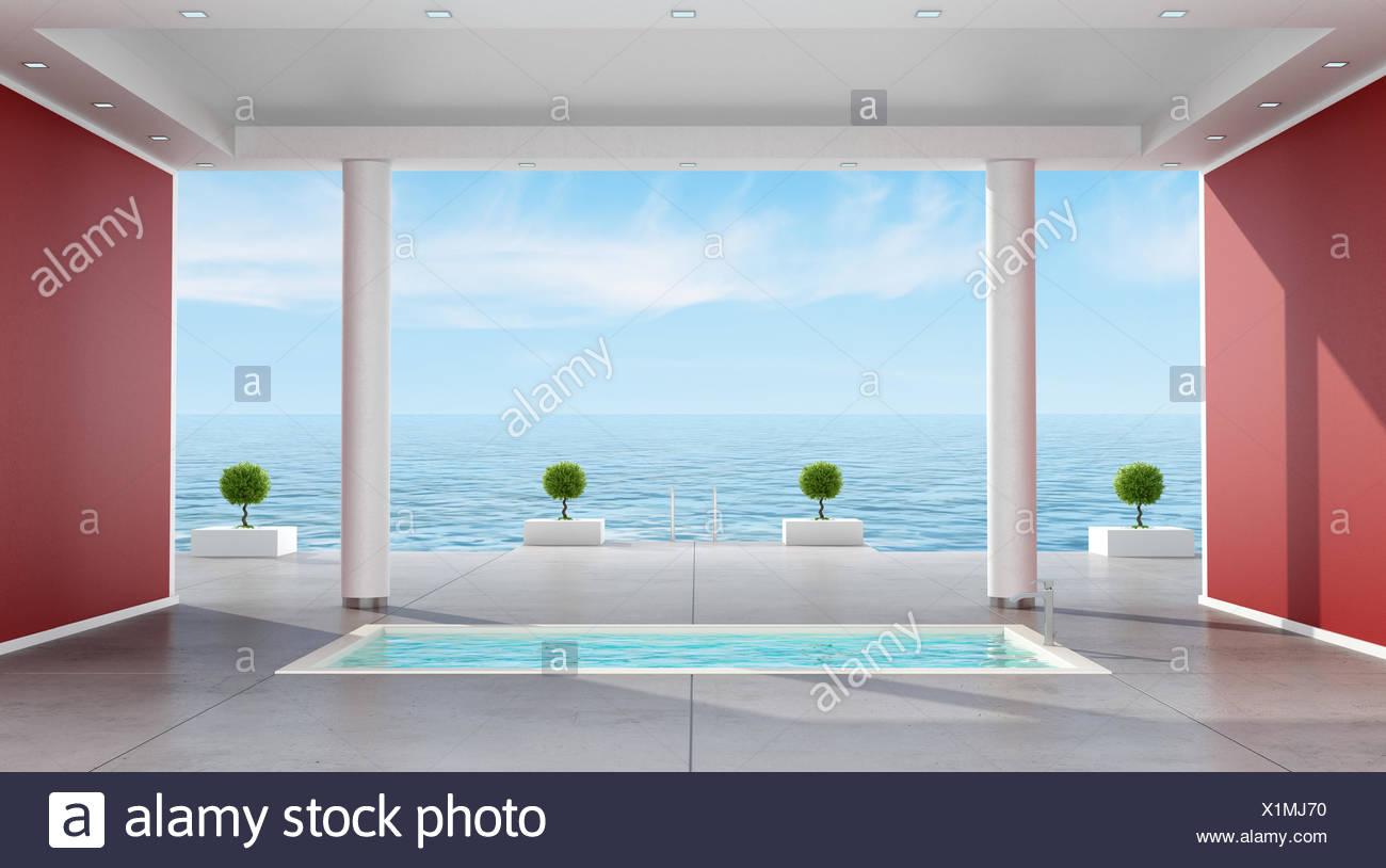 Cuarto de baño de lujo con bañera hundida en una villa con vistas al ...