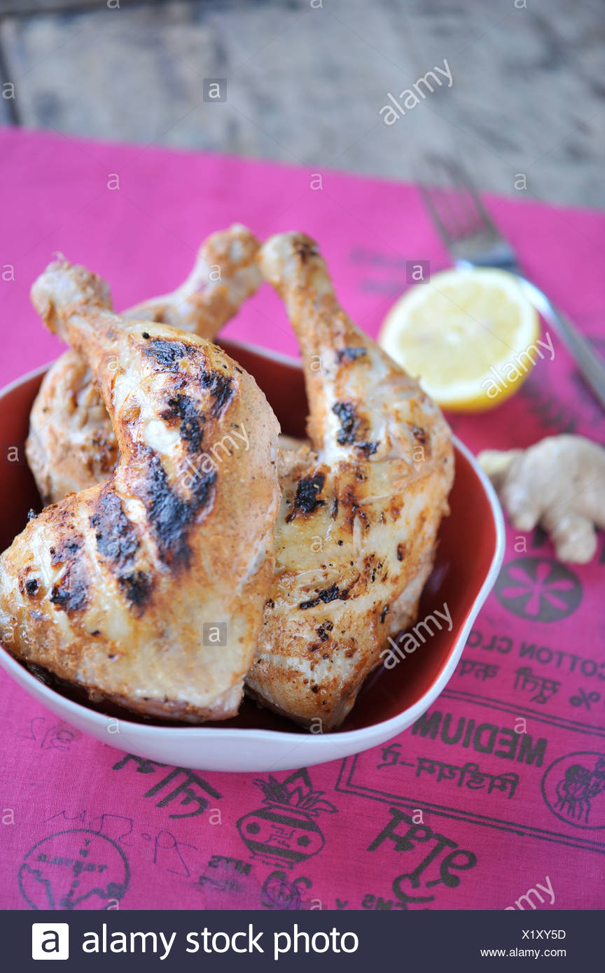 Piernas de pollo estilo Tandoori en Foto de stock