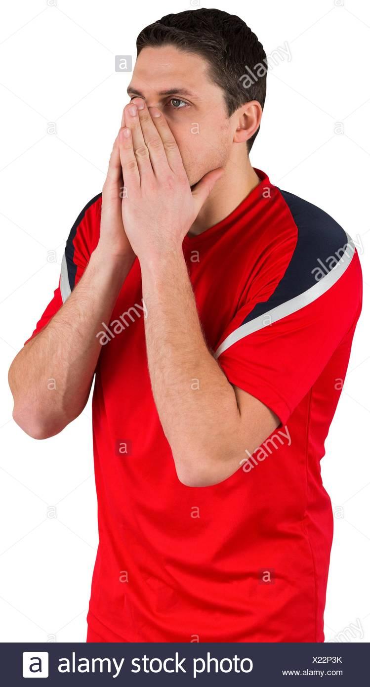 Jugador de fútbol nervioso mirando hacia adelante Imagen De Stock