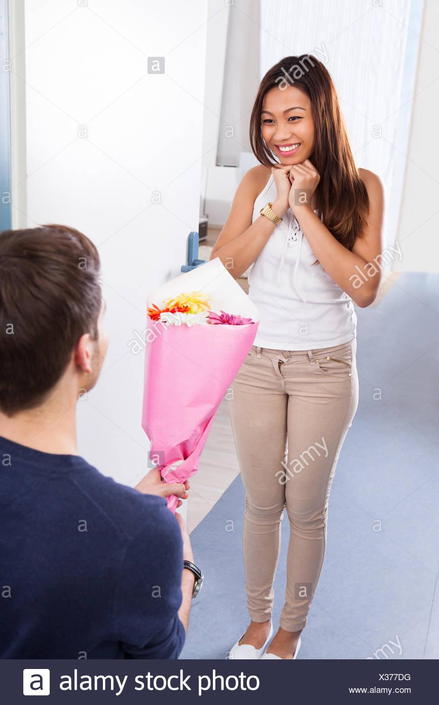 Man Woman Standing Doorway Flower Imágenes De Stock & Man Woman ...
