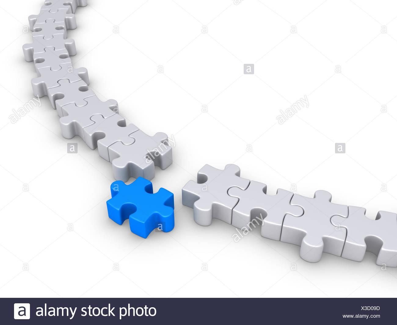 Una pieza del puzzle está fuera del círculo formado por otros Foto de stock