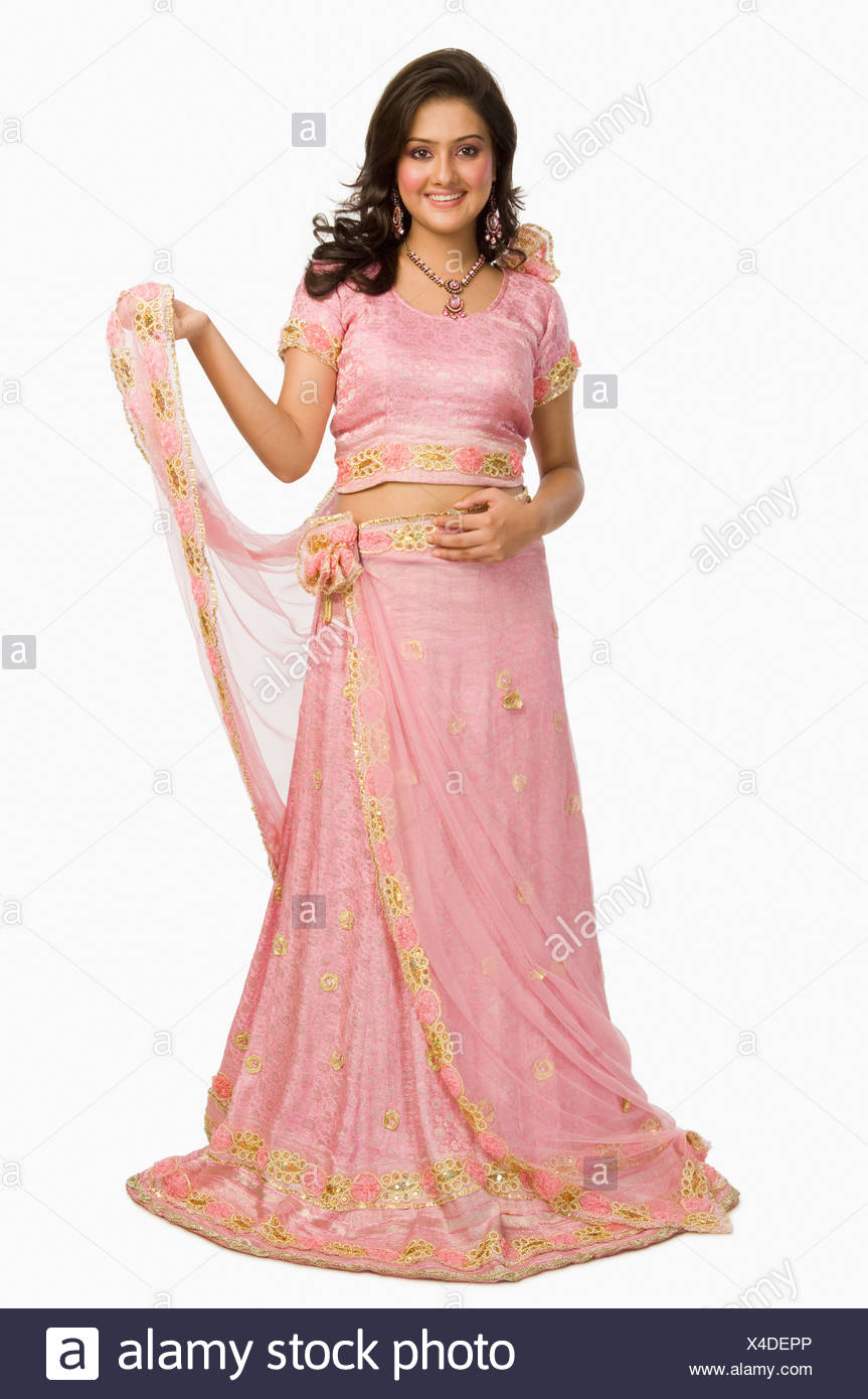 Woman In Traditional Dress Posing For Camera Imágenes De Stock ...