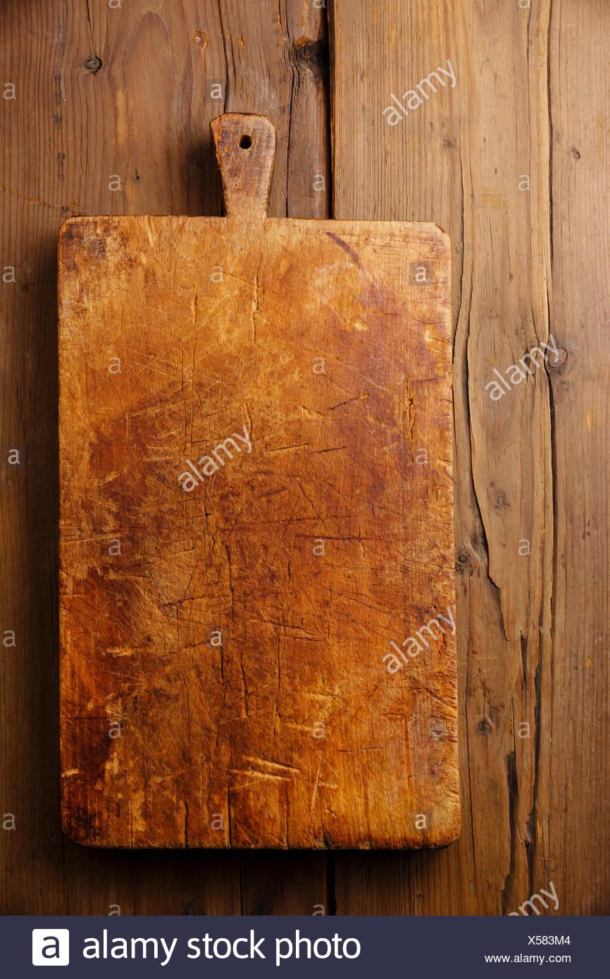 Picar la tabla de cortar el bloque de madera en la textura del fondo Imagen De Stock
