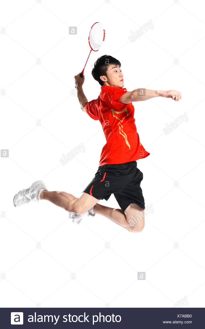 Los atletas masculinos jugar bádminton Imagen De Stock