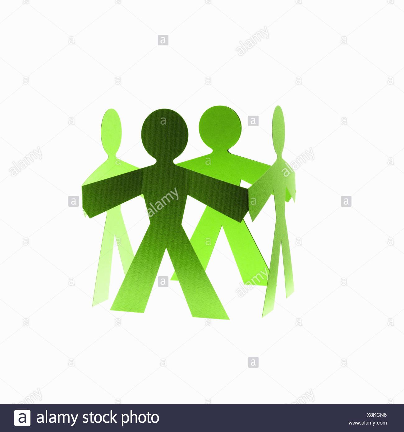 Papercuts papel cortado a gente con manos unidas Imagen De Stock