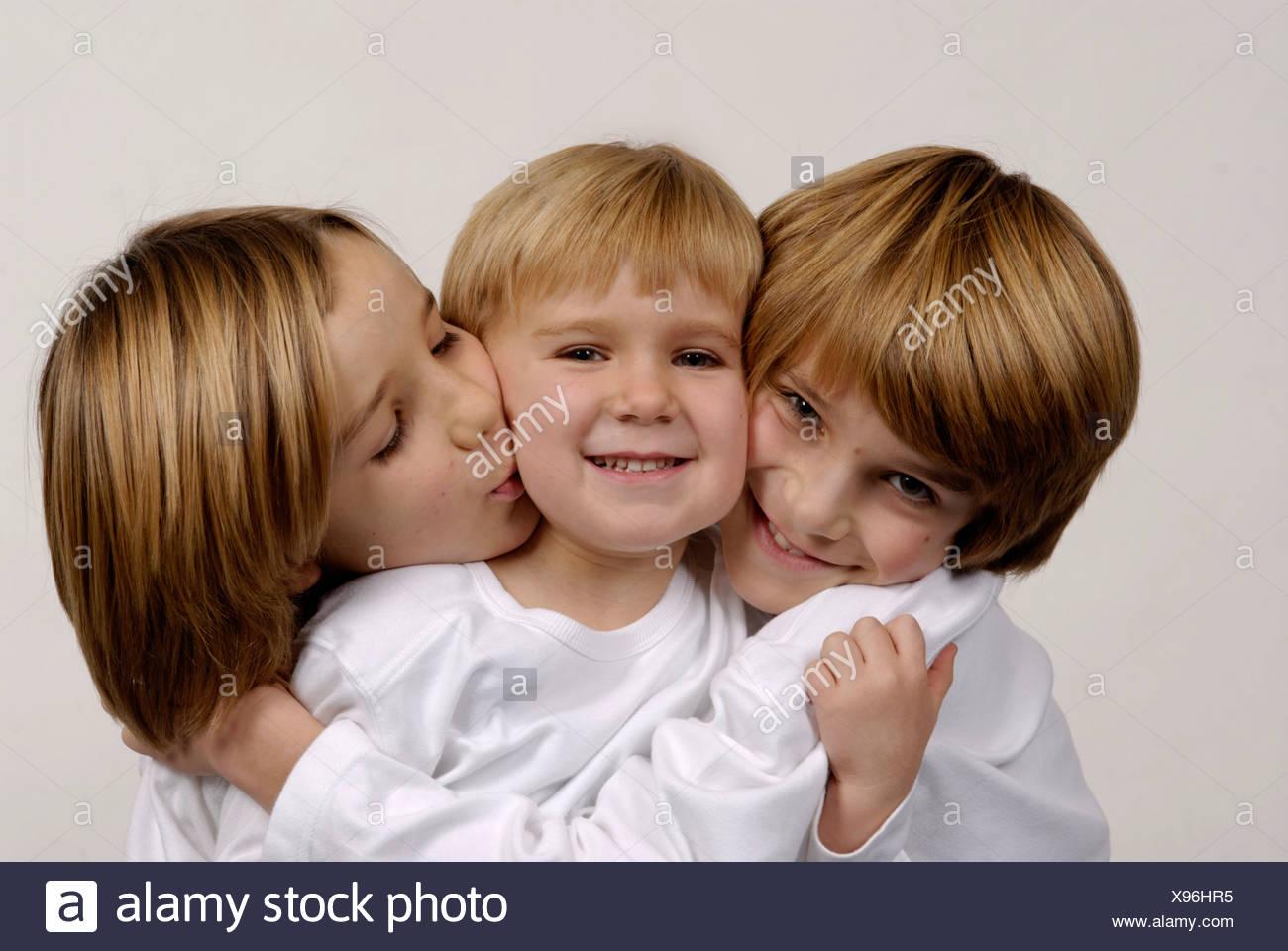 Tres hermanos, retrato, buscando similar Imagen De Stock