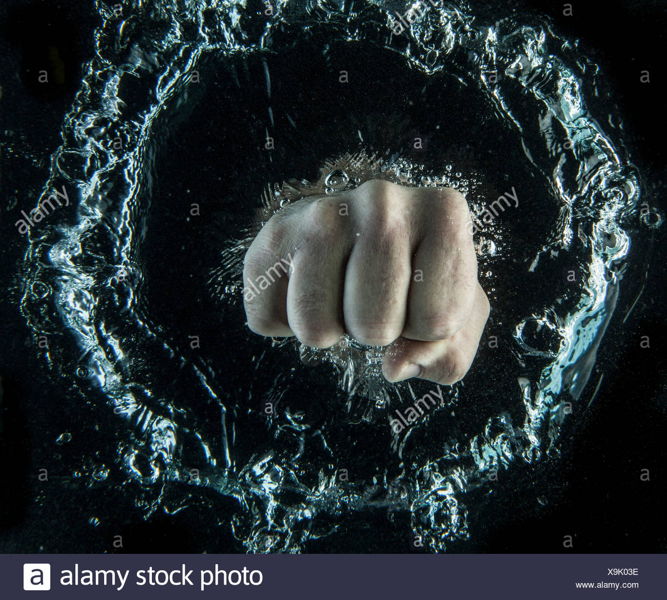 Cierre de puño bajo el agua Imagen De Stock