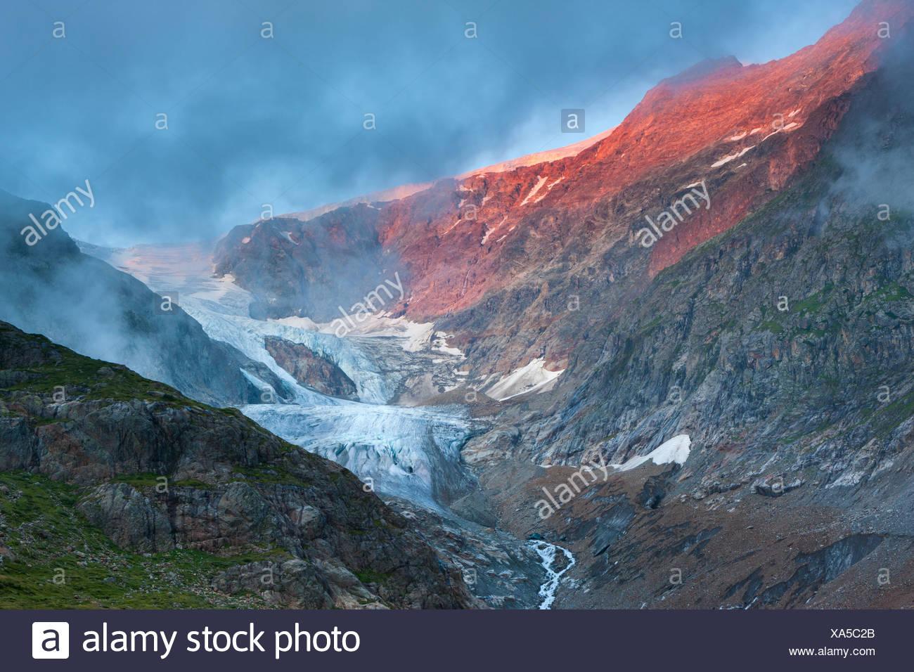 Glaciar Piedras, Suiza, Europa, cantón de Berna, en el Oberland Bernés Gadmental, glaciar, hielo, roca, Cliff, luz del atardecer Imagen De Stock