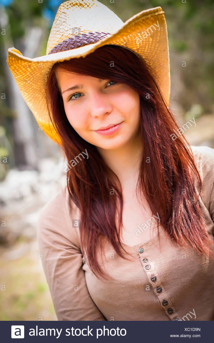 Usa Texas Portrait Cowgirl Smiling Imágenes De Stock   Usa Texas ... 88264ab4cb8