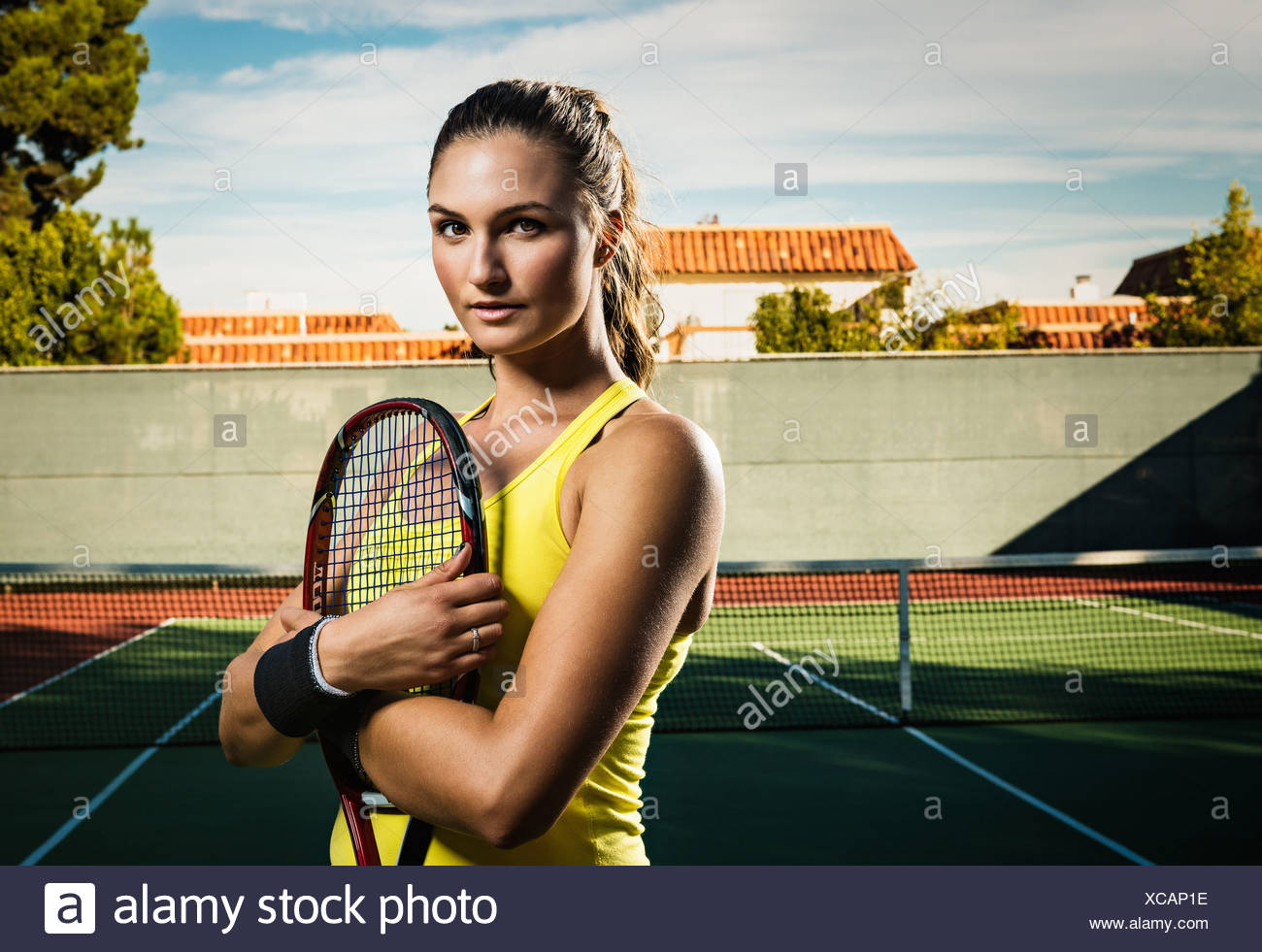 Jugador de tenis femenino celebración raqueta Imagen De Stock