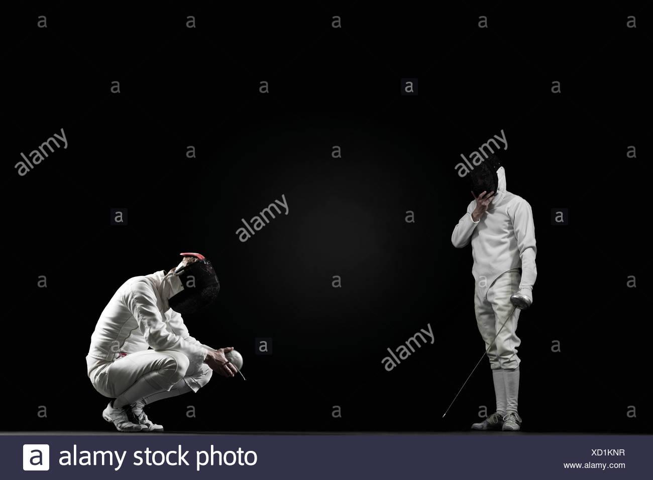 Ganar esgrimista y derrotado esgrimista Imagen De Stock