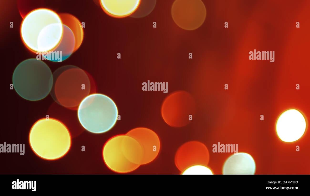 Résumé rouge floue lumières fond Noël lumineux Banque D'Images