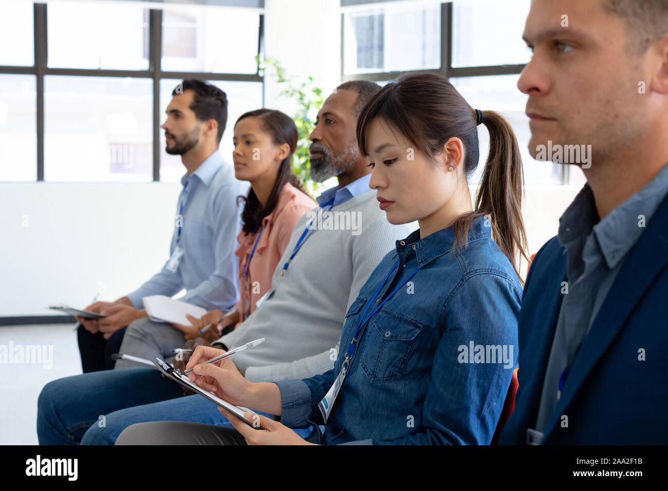 Les employés des entreprises dans une conférence Banque D'Images