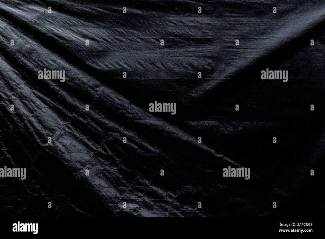 Bâche grise froissée. Arrière-plan texturé plein format abstrait haute résolution sombre. Banque D'Images