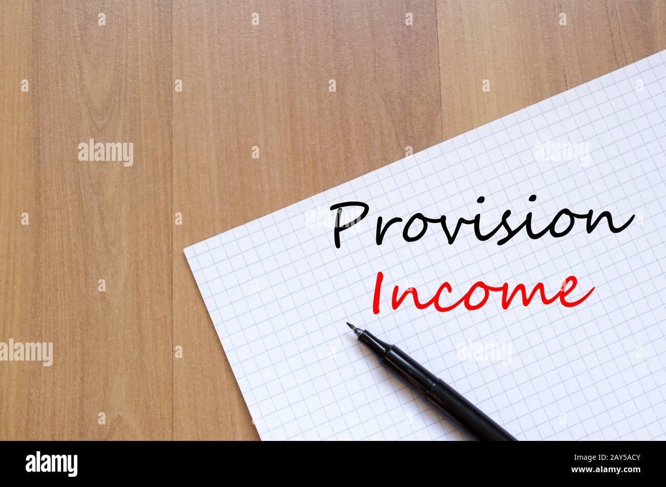 Écrire sur le revenu disposition notebook Banque D'Images