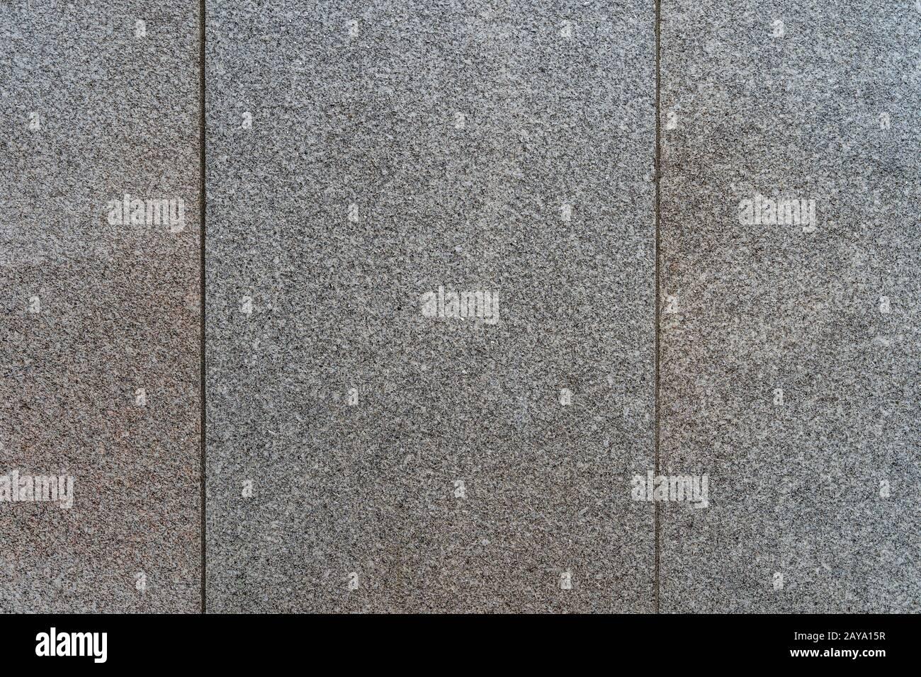 Vieux granit gris avec des motifs fins. Texture et arrière-plan de haute qualité Banque D'Images