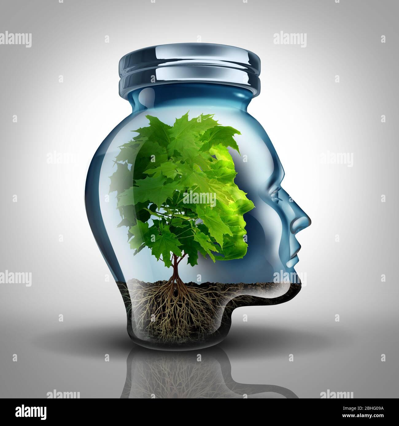 Concept de psychologie de la croissance intérieure et idée de développement personnel comme un pot en verre façonné comme une tête humaine avec un arbre à l'intérieur représentant la santé mentale. Banque D'Images