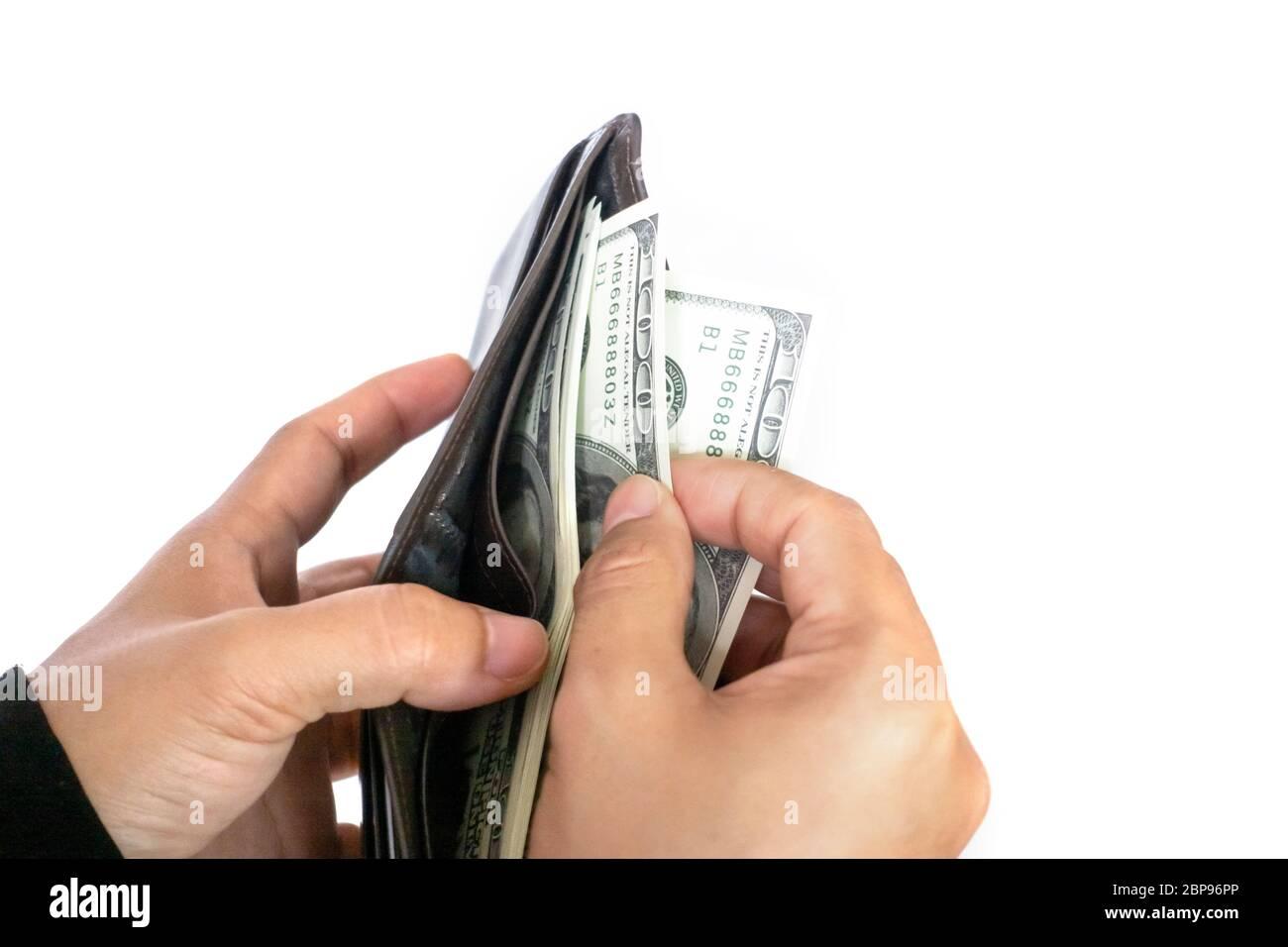 Femme de prendre de l'argent dollar billets de wallet Banque D'Images