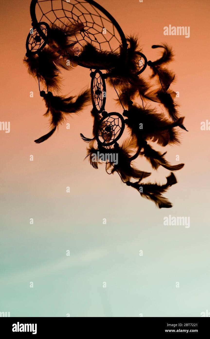 dreamcatcher en silhouette au coucher du soleil Banque D'Images