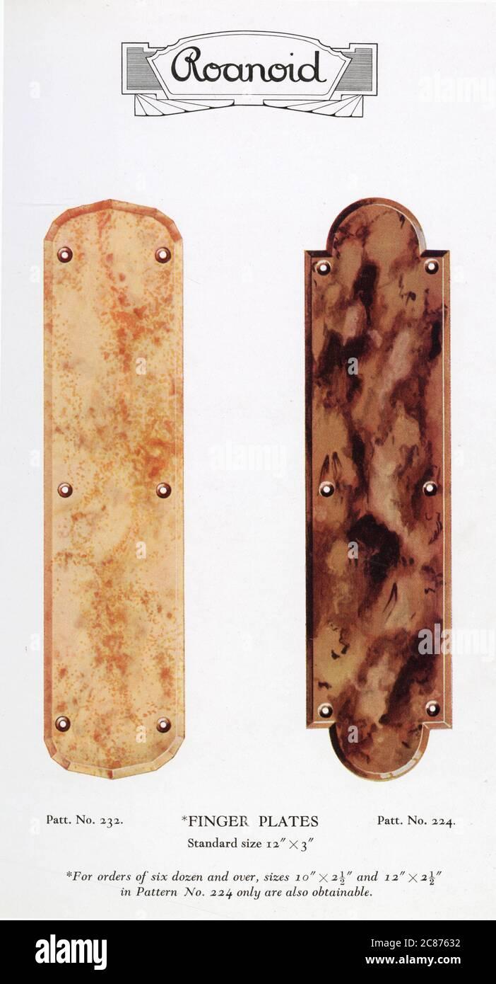 Plaques de doigts de bakélite de Roanoid, l'une dans la crème marbrée, l'autre dans le brun marbré. Date: Années 1930 Banque D'Images