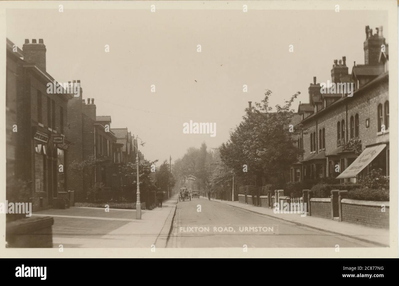 Flixton Road, Urmston, Trafford, Manchester, Lancashire, Angleterre. Date: 1920 Banque D'Images